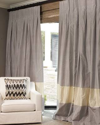 CURTAINS WITH A WIDE BORDER NEAR THE BOTTOM