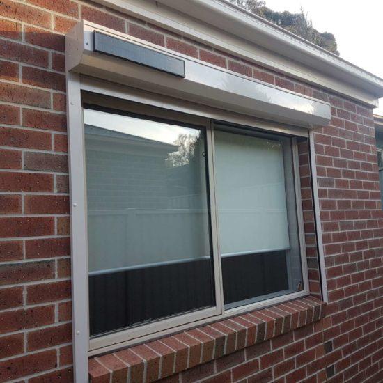 motorised window roller shutter