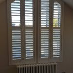 shaped plantation shutter